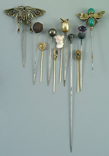 14: Eleven assorted stick and hat pins, brass