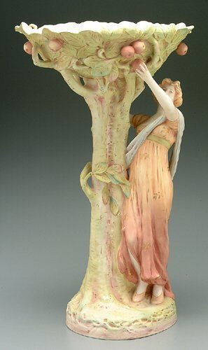 617: Majolica figure of woman picking fruit f