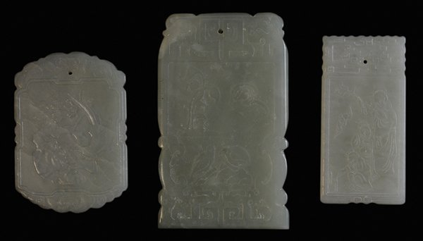 Three Carved Green-to-White Jade