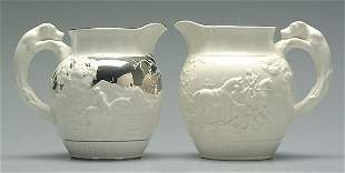 Two Wedgwood hound handle pitchers