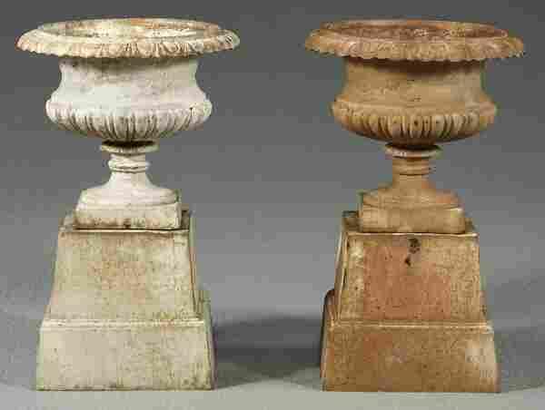 Pair cast iron urns,