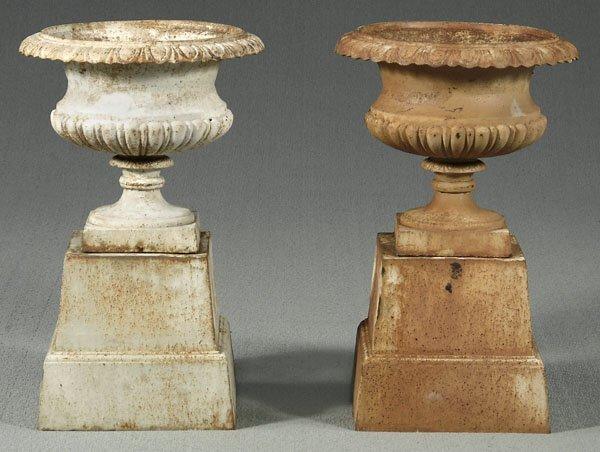 11: Pair cast iron urns,