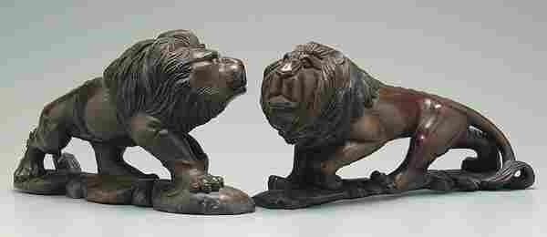 Two similar carved wood lions,
