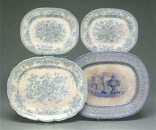 Four blue transferware platters