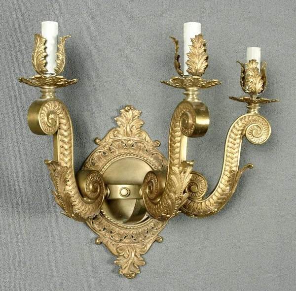 23: Three cup polished brass wall sconce,