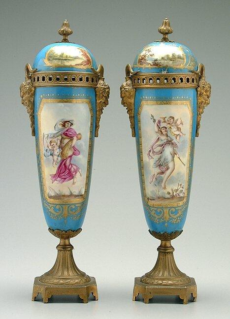 12: Pair Sèvres style lidded jars,