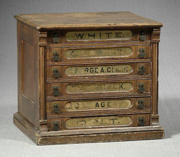 22: White Clark's chestnut spool cabinet,