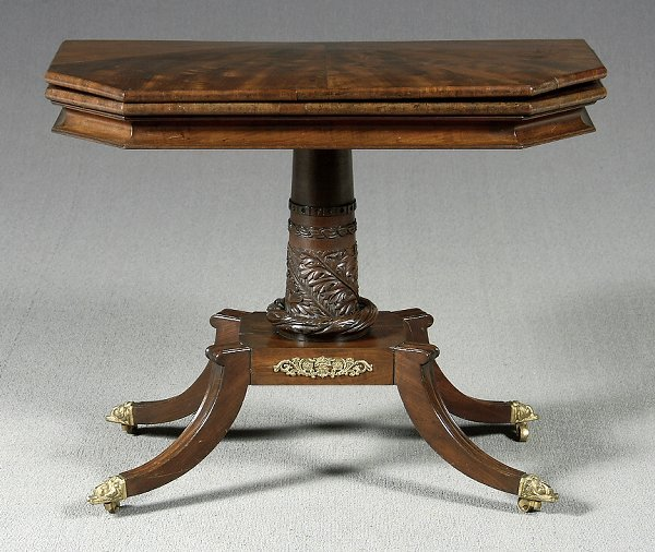 54: Empire mahogany games table,