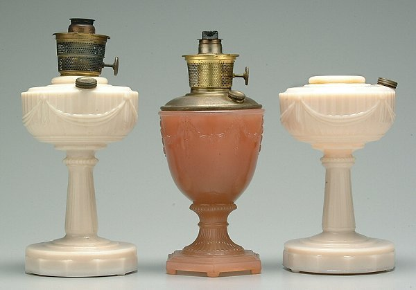 209: Three Aladdin glass oil lamps: