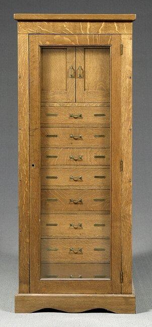 638: Oak vertical cabinet,