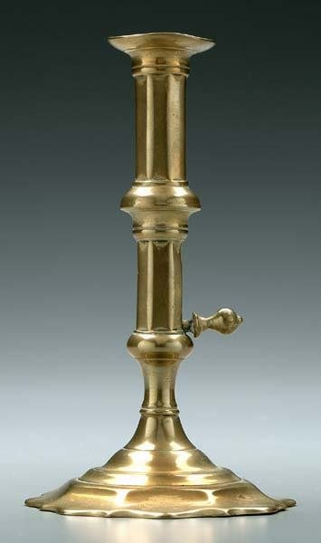 23: Brass push-up candlestick,