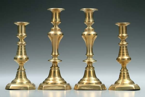 24: Two pairs brass push-up candlesticks:
