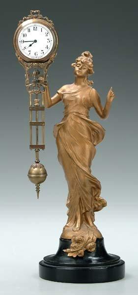 8: Art Nouveau figural wagging-arm clock,