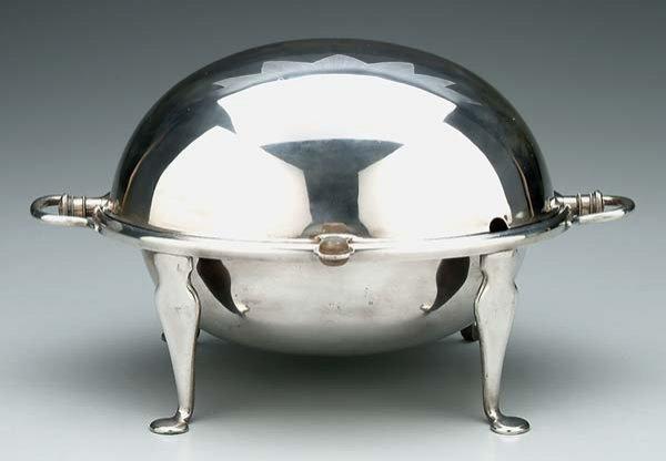24: Revolving silver server,
