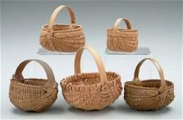 554: Five miniature oak split baskets: