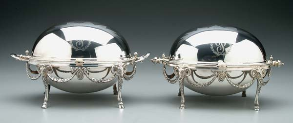 615: Two similar silver-plated servers,
