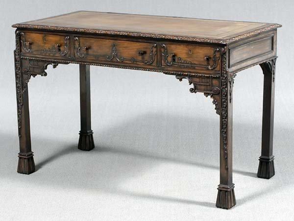 621: Carved mahogany library table,