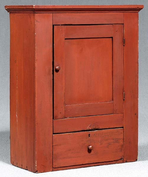 761: Red-painted hanging cupboard,