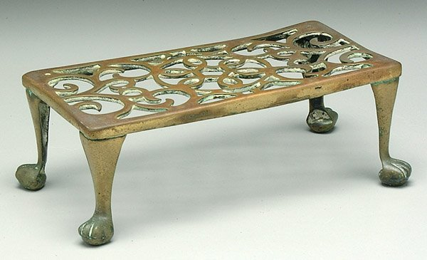 11: 19th century brass trivet,