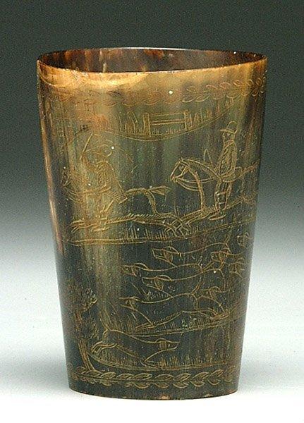 17: Horn cup, engraved hunt scene,