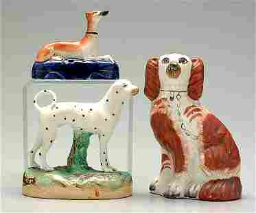 Three Staffordshire figural dogs