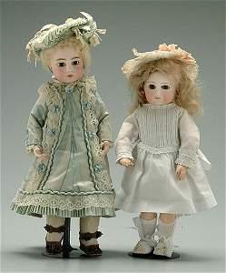 457: Two bisque head dolls: