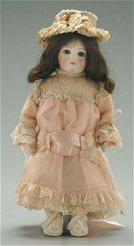 531: Bisque head doll,