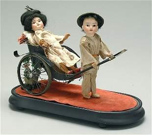 Two bisque head dolls