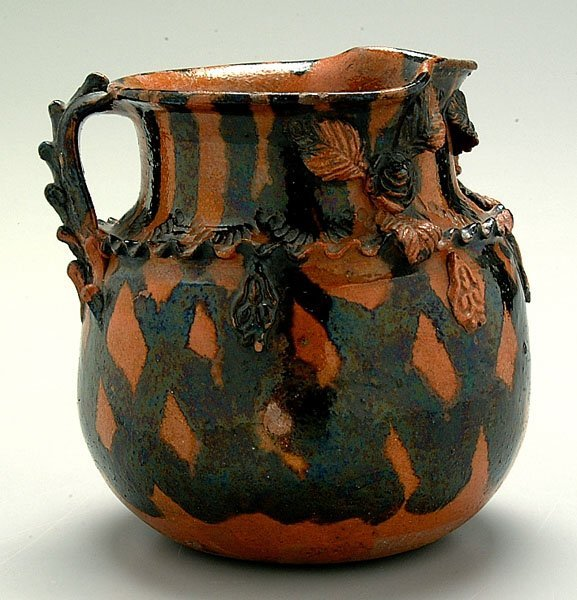 611: Decorated redware pitcher,