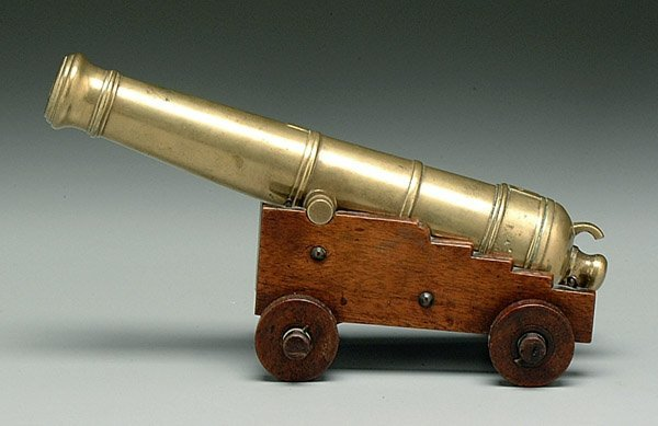 605: Miniature cast brass cannon
