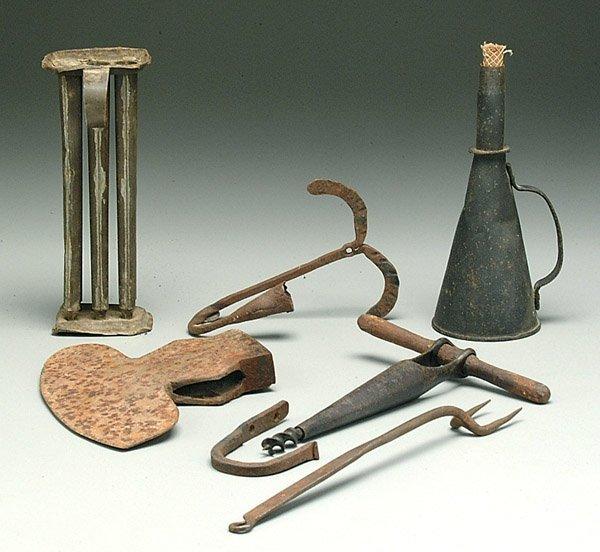 611: Seven early iron, tin tools: