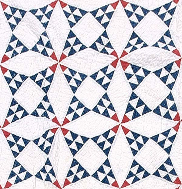 603: Hand-stitched and pieced quilt,