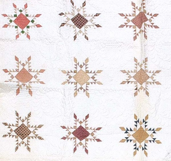 608: Hand-stitched and pieced quilt,