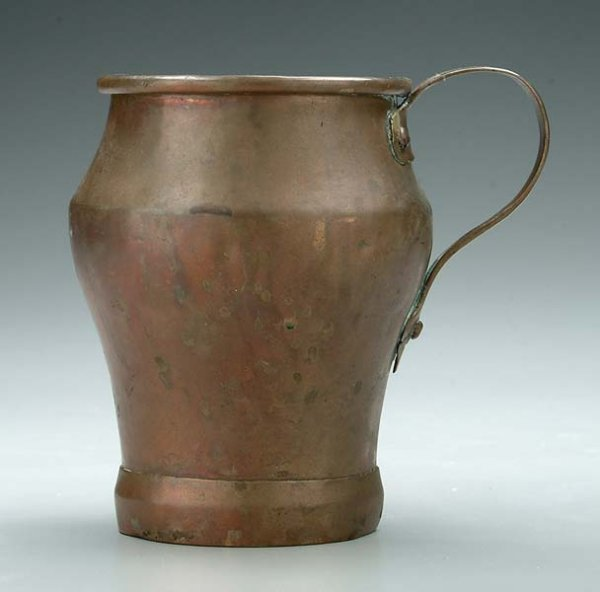 6: Dovetailed brass pitcher,