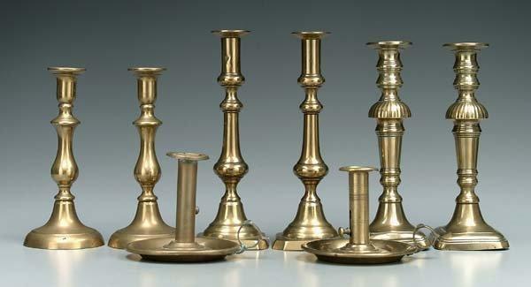 7: Eight brass candlesticks: