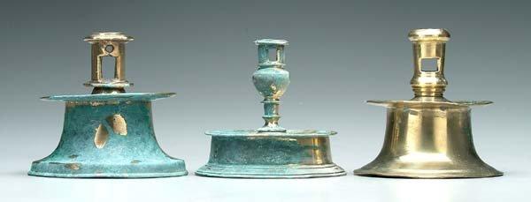 12: Three 17th century brass candlesticks:
