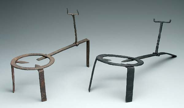 20: Two wrought iron trivets: