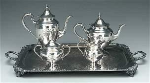 558: Four-piece sterling tea service: