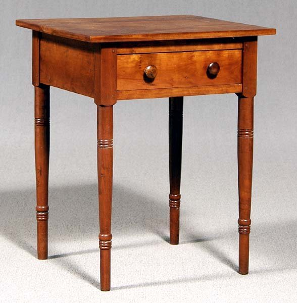 606: Federal cherry one-drawer table,