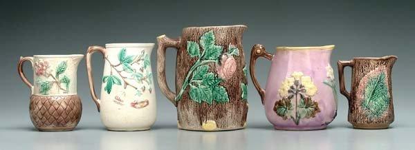 619: Five majolica pitchers: