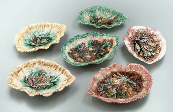 627: Six leaf-shaped majolica dishes: