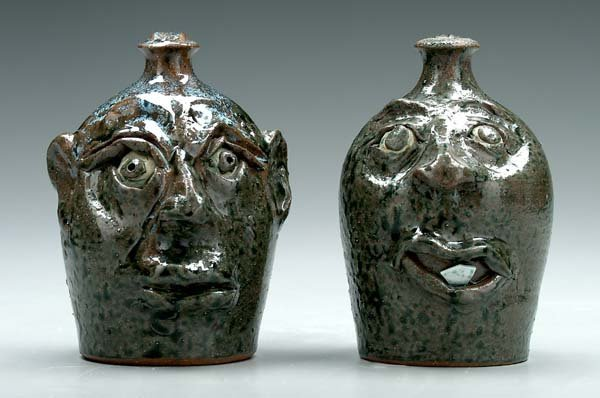 10: Two Bill Flowers stoneware face jugs: