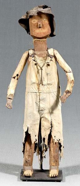 534: Wooden scarecrow,