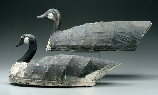 555: Two canvas and wire goose decoys: