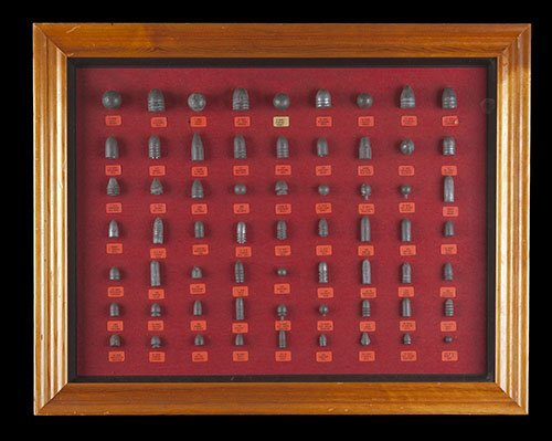 AN INTERESTING FRAMED AND GLAZED LEAD BULLET DISPLAY