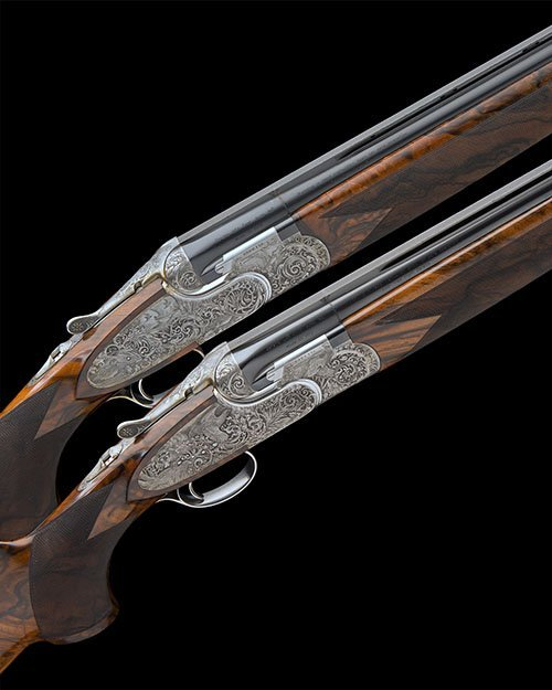 P  BERETTA AN EXCEPTIONAL PAIR OF PEDERSOLI-ENGRAVED