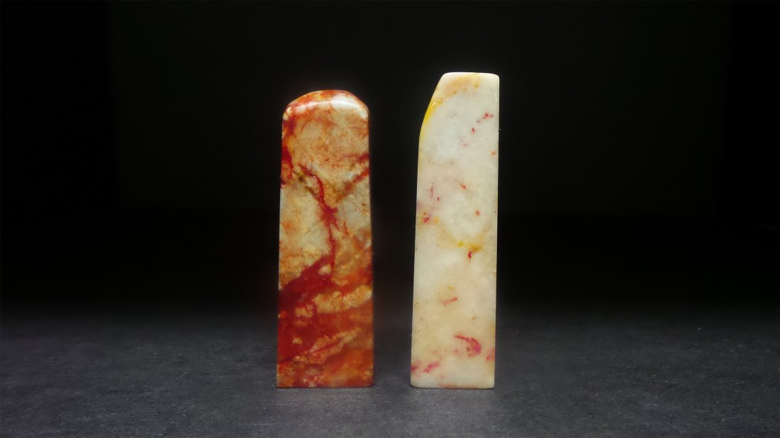 A PAIR OF SOAPSTONE SEAL