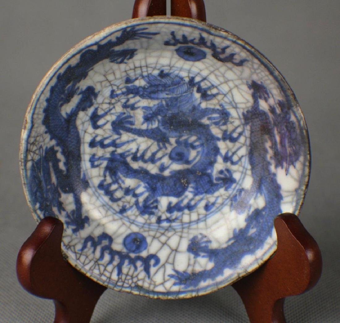 A Blue and White Ming Porcelain Plate,signed
