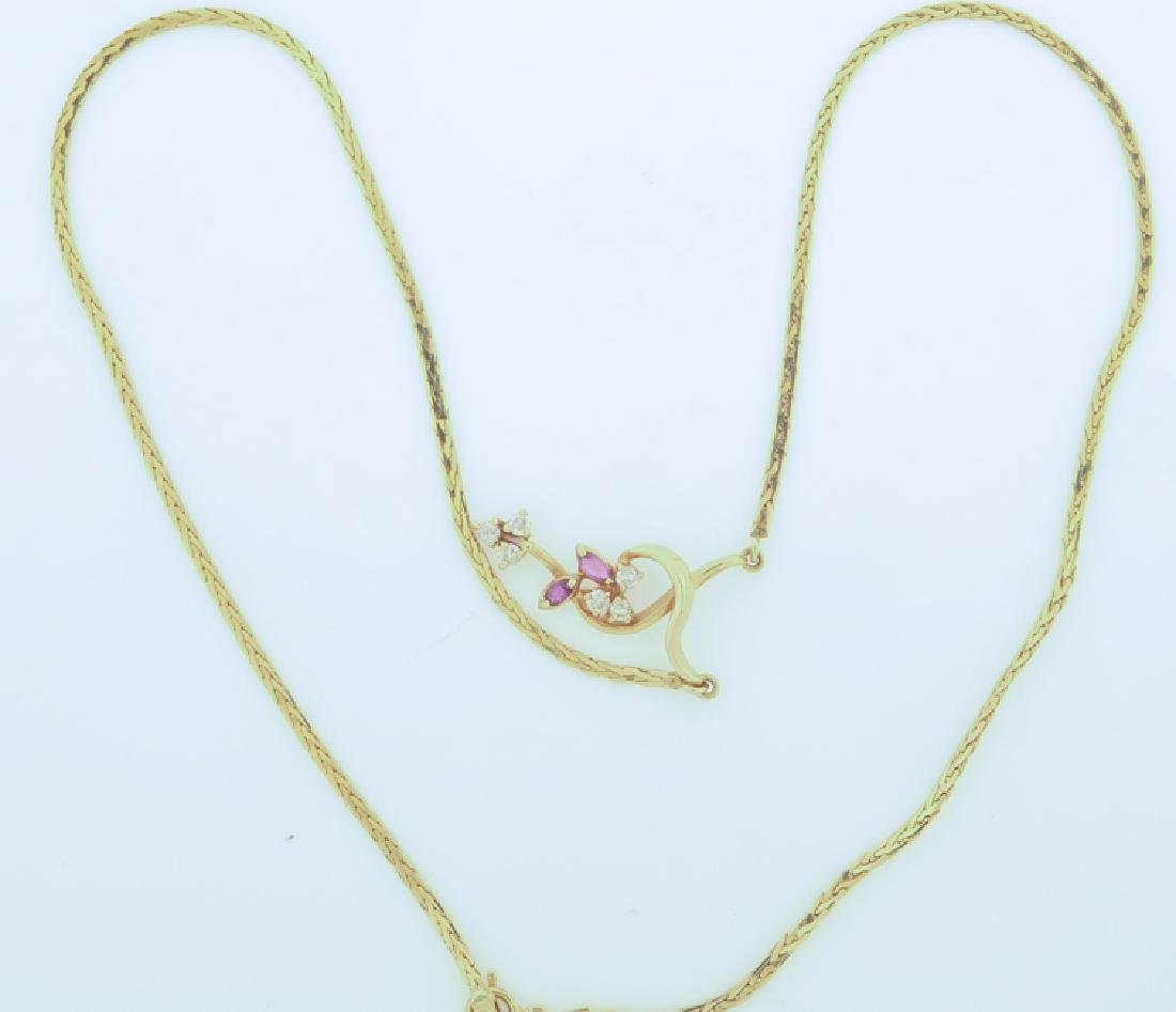 Chain 14k Italy with diamands and pink sapphire