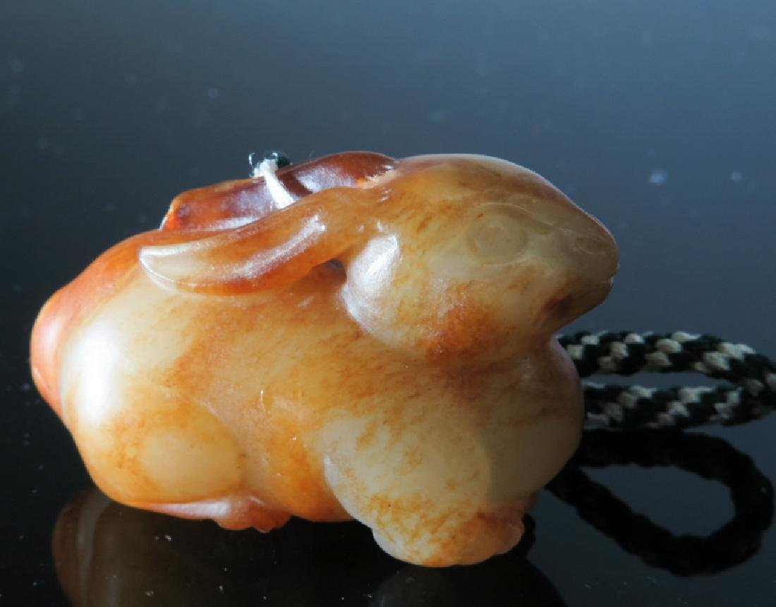 A yellow and brown jade rabbit - 2